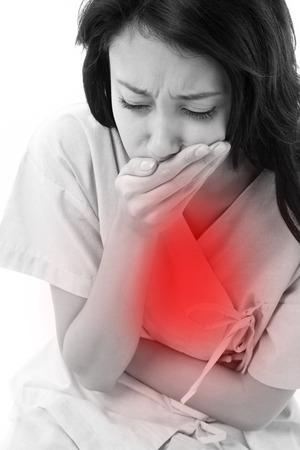 vomito: mujer paciente con síntomas de las náuseas Foto de archivo