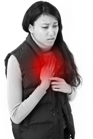 acid reflux: woman suffering from acid reflux or heartburn Stock Photo
