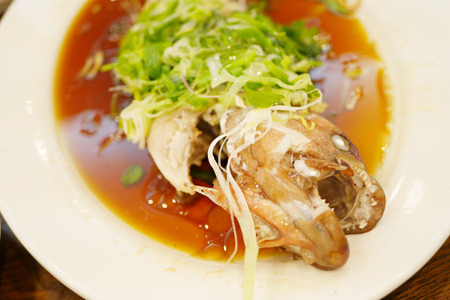 fish plate: steamed sea fish, fish head is soy sauce in exotic scary style, chinese food Stock Photo