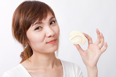 happy woman eating vanilla roll cake