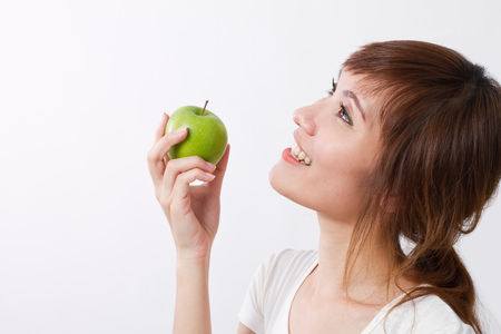 healthy looking: healthy asian woman looking up, hand holding green apple Stock Photo