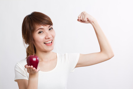 healthy looking: healthy, strong asian woman with red apple, looking at you