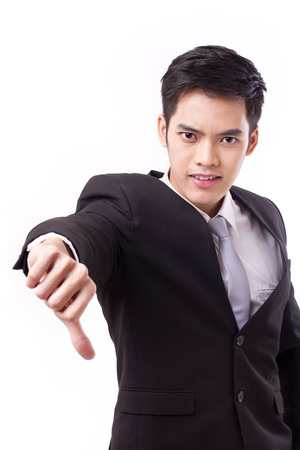 asian business man: frustrated businessman giving thumb down