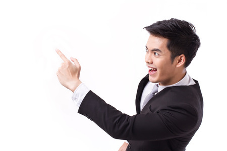 successful, happy businessman pointing up at blank space