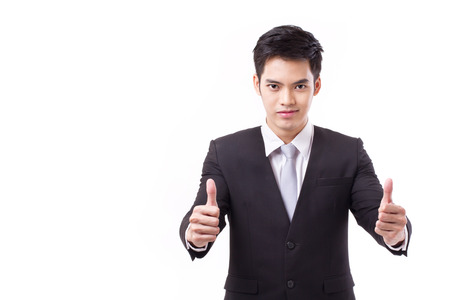 two thumbs up: successful businessman giving two thumbs up, with text space