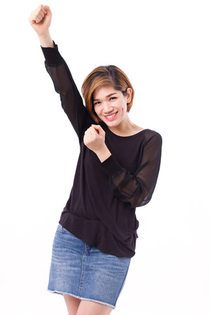 raising: happy, smiling, exited woman looking at you, studio isolated of asian chinese-thai woman model.