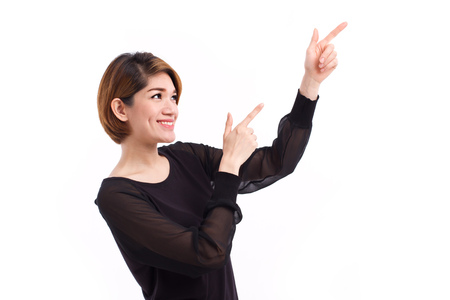 hand pointing: happy woman pointing hand and finger up to blank space, studio isolated of Chinese Thai asian woman model.