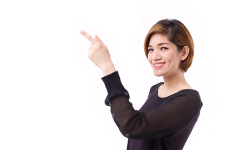 woman pointing: happy woman pointing hand and finger up to blank space, studio isolated of Chinese Thai asian woman model.