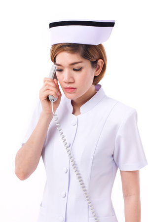 a lady doctor: serious nurse working, listening the phone call