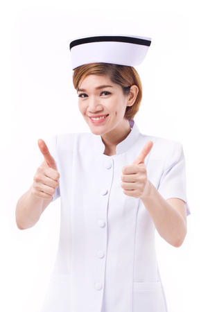 two thumbs up: smiling nurse giving two thumbs up gesture Stock Photo