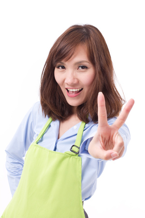 hand pointing: smiling, happy, positive woman with hand pointing up 2 fingers or v sign, concept of counting, numbering, sorting, pointing out something Stock Photo