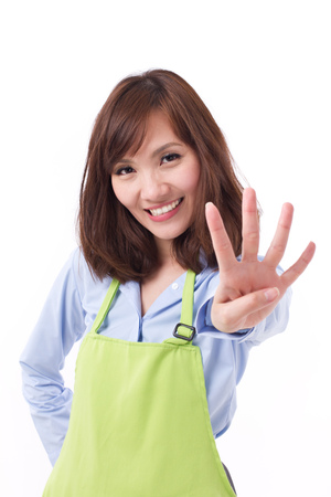 hand pointing: smiling, happy, positive woman with hand pointing up 4 fingers, concept of counting, numbering, sorting, pointing out something