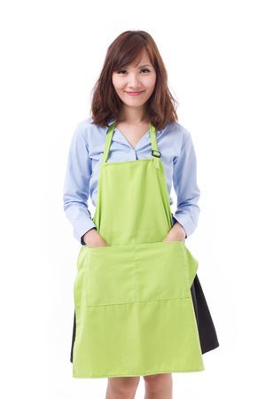 shop keeper: smiling, happy, confident staff, employee, shop keeper with apron, studio isolated Stock Photo
