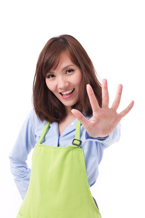 numbering: smiling, happy, positive woman with hand pointing up 5 fingers, concept of counting, numbering, sorting, pointing out something Stock Photo