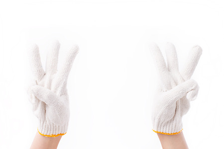 three fingers: worker double hands pointing up three fingers, with cotton glove