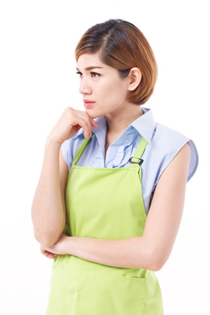 delantal: confident, smart woman with apron thinking, planning