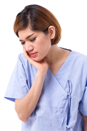 sensitivity: woman suffering from toothache, tooth decay or sensitivity