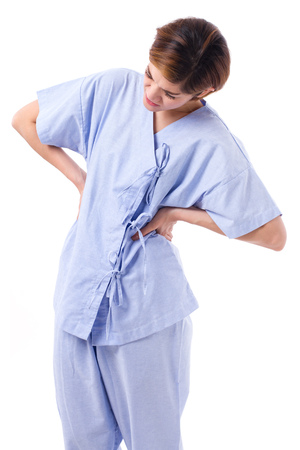 the backbone: woman suffering from back pain, backbone or spinal muscle injury