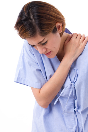 stiffness: woman with shoulder or neck pain, stiffness, injury Stock Photo