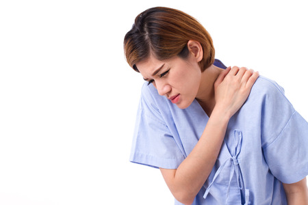 suffer: woman with shoulder or neck pain, stiffness, injury Stock Photo