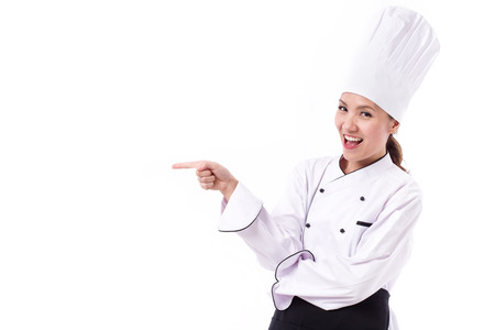 sideway: happy, smiling, positive female chef pointing sideway Stock Photo