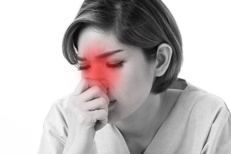 cold: woman catching a cold, runny nose