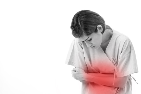 excessive: woman suffering from stomachache, menstrual cramp, excessive gas Stock Photo