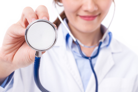 confident, happy, positive female doctor's hand holding stethoscope
