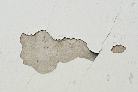 grunge peeling paint wall textured background, brown or beige tone