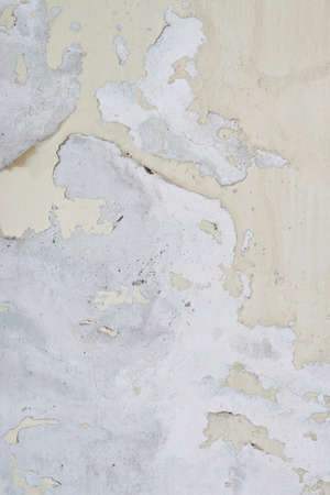 foundation cracks: grunge peeling paint wall textured background, brown or beige tone
