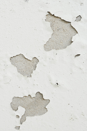 foundation cracks: grunge peeling paint wall textured background, light brown or beige tone