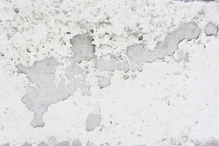 paint peeling: grunge peeling paint wall textured background, light brown or beige tone