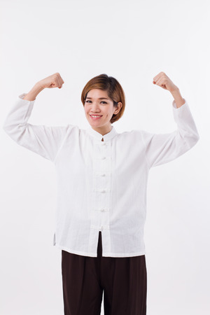 self defense: happy, strong, confident kungfu woman, self defense and Chinese martial arts concept Stock Photo