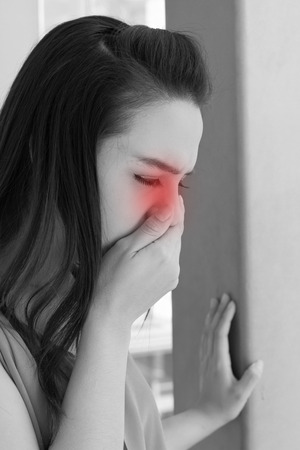 queasy: woman with cold or flu, running nose