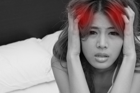 sleeplessness: woman suffers from headache, migraine, emotional stress, insomnia or sleeplessness with messy hair and facial expression