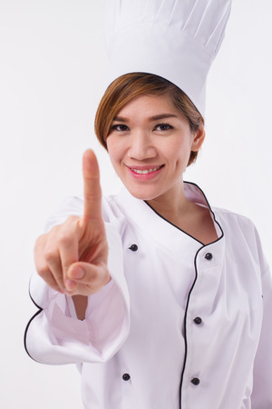 one female: female asian chef pointing up one finger gesture Stock Photo