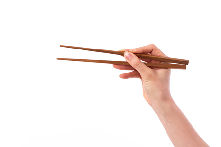 hand holding chopsticks, picking or selecting something on side blank space