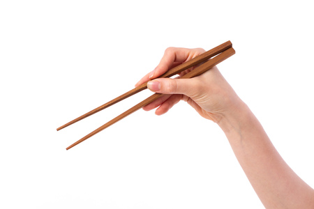 hand holding chopsticks, picking or selecting something down on blank space Standard-Bild