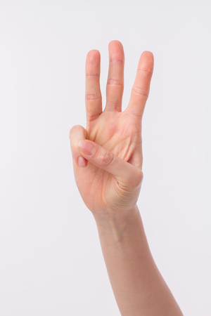 hand pointing up 3 finger gesture Stock Photo