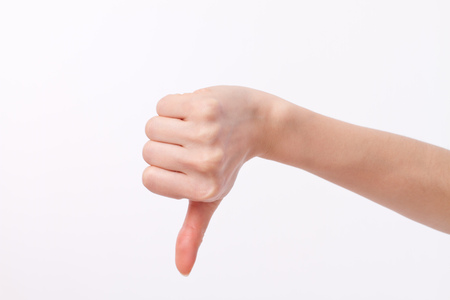 hand showing thumb down, dislike, bad, disapproval, unacceptance, not okay, not ok, negative gesture Stock Photo