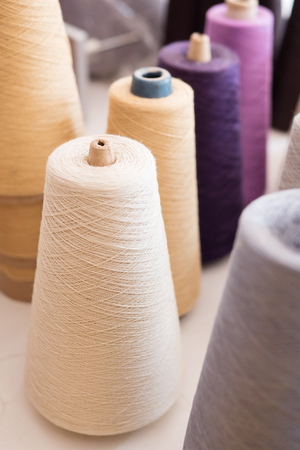 coser: yarn roll in textile manufacturing factory, industrial raw material