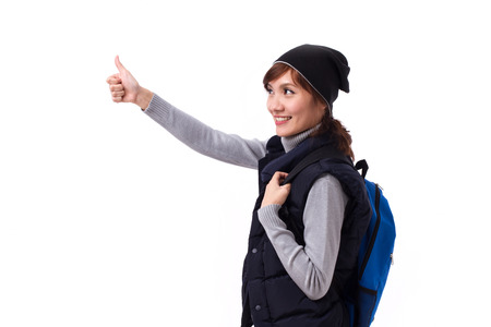 thumbup: happy, smiling woman traveler giving thumb up
