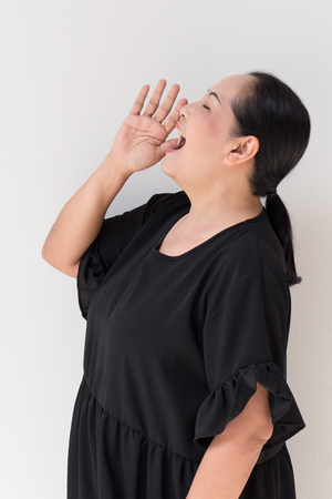 middle age woman shouting up Stock Photo