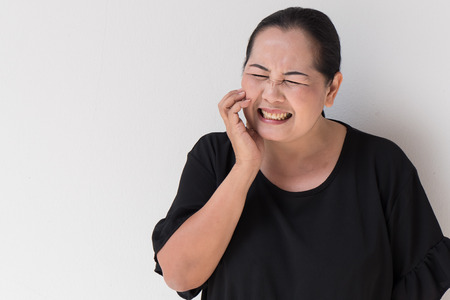 woman suffering from toothache, tooth sensitivity, decay, oral problem Stock Photo