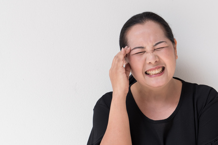 tension: middle age woman suffering from headache, stress, tension, migraine, insomnia, pain