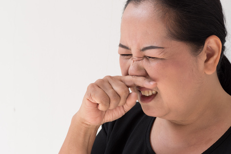 snort: sick woman with cold sniffing
