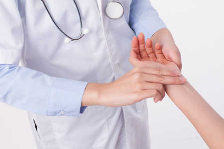 Traditional chinese doctor measuring pulse of patient, alternative medicine concept