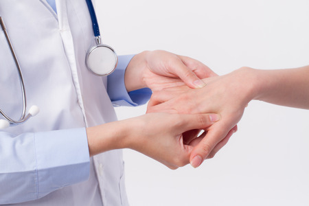 middle joint: Doctor inspecting patient body, professional health care concept
