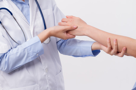 treating: Doctor inspecting patient body, professional health care concept