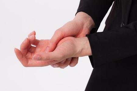 Businesswoman Suffering From Hand Or Wrist Injury Arthritis